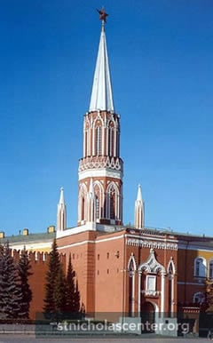 Red brick Gothic tower with spire