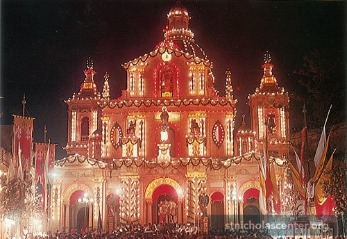 Brightly decorated church, festooned with lights