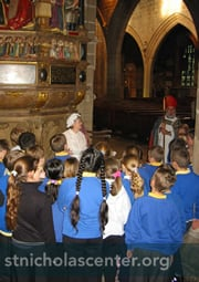 St Nicholas with school children at Newcastle Cathedral