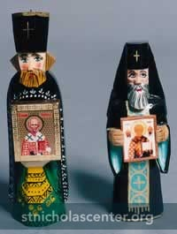 Handcarved Orthodox priests with St Nicholas icons
