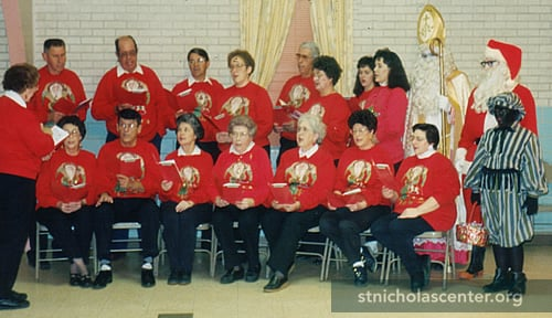 Choir in red Santa sweatshirts