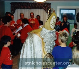 Saint Nicholas talking to children