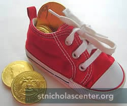 Red shoe with gold coins
