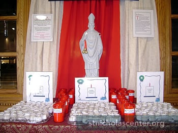 Shrine with statue, candles, signs