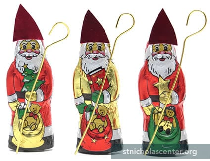Small solid chocolate Santa into St Nicholas
